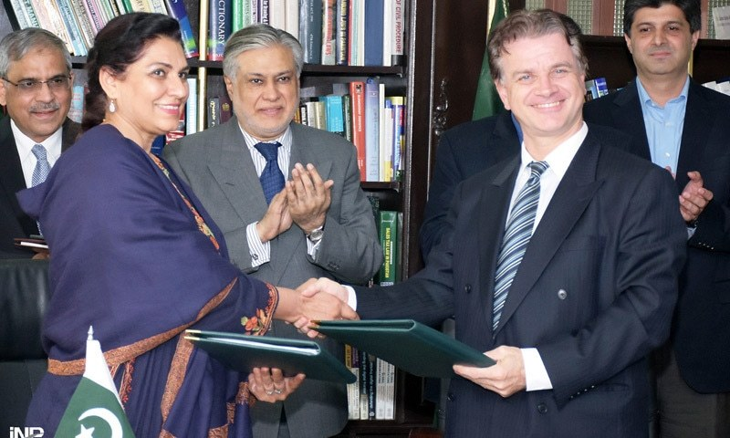 ISLAMABAD: Additional Secretary Economic Affairs Division Anjum Assad Amin and ADB Country Director Werner E. Liepach exchanging documents after signing loan agreement on Tuesday.— INP