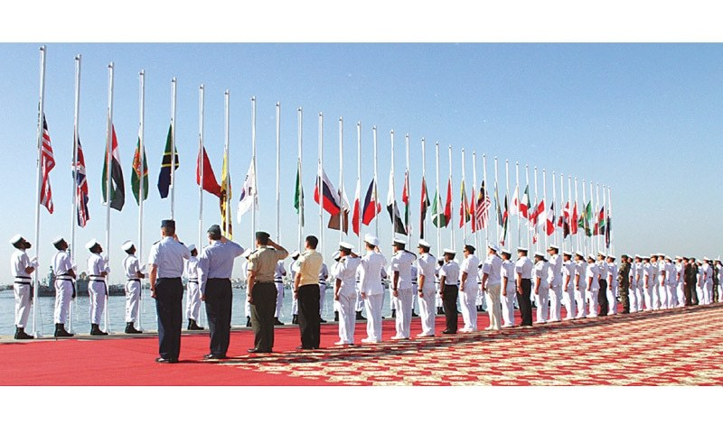 KARACHI: Colourful flag hoisting during the opening ceremony of the naval exercise.—APP