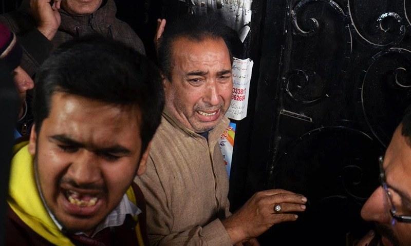 Relatives of victims of the bomb blast seen outside Ganga Ram Hospital, Lahore. ─APP