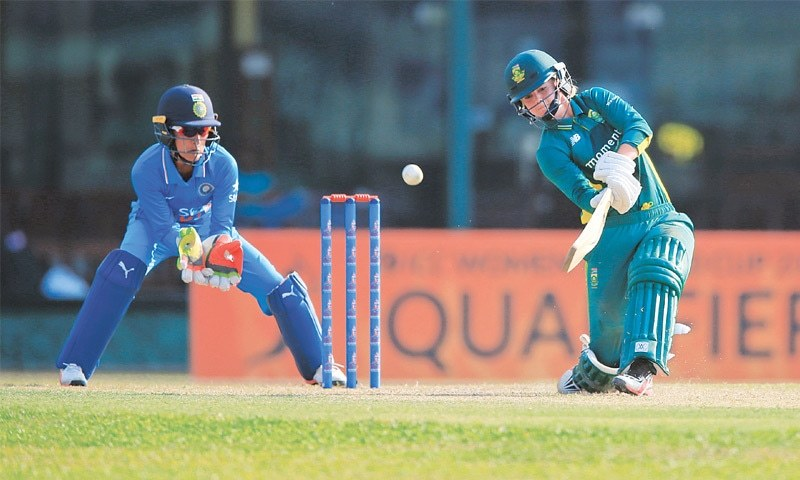 COLOMBO: South African captain Dane van Niekerk drives as Indian wicket-keeper Sushma Verma looks on during their Women's ICC World Cup Qualifier on Wednesday.—AP