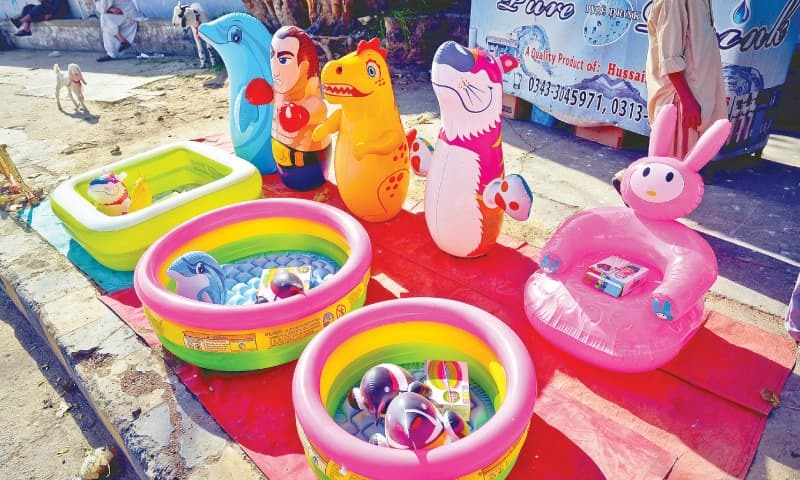 A roadside shop of inflatable toys and paddling pools.