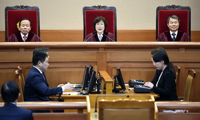 South Korean acting Constitutional Court's Chief Judge Lee Jung-mi, top centre, speaks during the final ruling of South Korean President Park Geun-hye's impeachment at the Constitutional Court in Seoul, South Korea Friday, March 10.