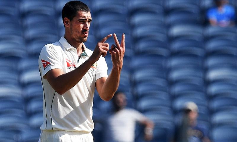 This file photo taken on February 24, 2017 shows Australia's Mitchell Starc gesturing during the second day of the first cricket Test match between India and Australia at the Maharashtra Cricket Association Stadium in Pune.— AFP