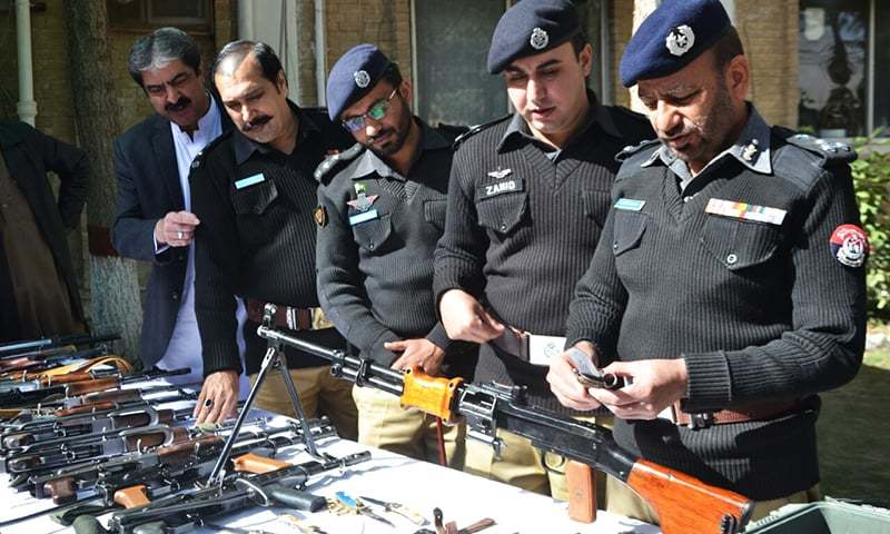 DIG Abdul Razzaq Cheema inspecting weapons recovered by police in the Nawan Killi area. -Asmatullah Kakar