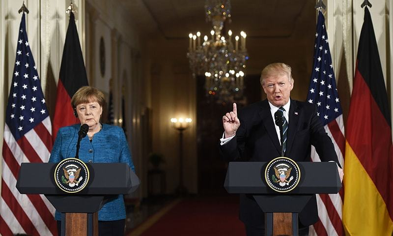 Germany vows legal action if Trump taxes imports