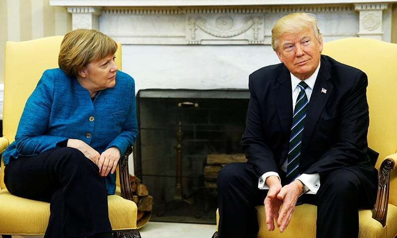 US President Donald Trump meets with Germany's Chancellor Angela Merkel in the Oval Office at the White House in Washington, March 17.— Reuters