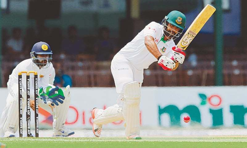Bangladeshi batsman Tamim Iqbal plays a shot as Sri Lanka's wicketkeeper Niroshan Dickwella watches on day five of their second test cricket match in Colombo, Sri Lanka, Sunday.— AP