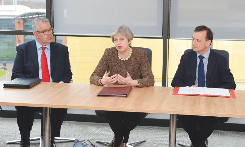British Prime Minister Theresa May with Welsh First Minister Carwyn Jones (left) and British Wales Secretary Alun Cairns (right) during a meeting at Swansea University's Bay Campus in Swansea, Wales, on Monday. May has begun a tour of Wales, Scotland and Northern Ireland aimed at boosting support for Brexit.—AFP