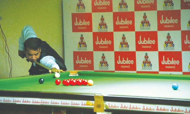 KARACHI: Ace cueist Mohammad Sajjad breaks the bunch of balls against Nadir Miraan in the 42nd National Snooker Championship at Karachi Gymkhana on Monday.
