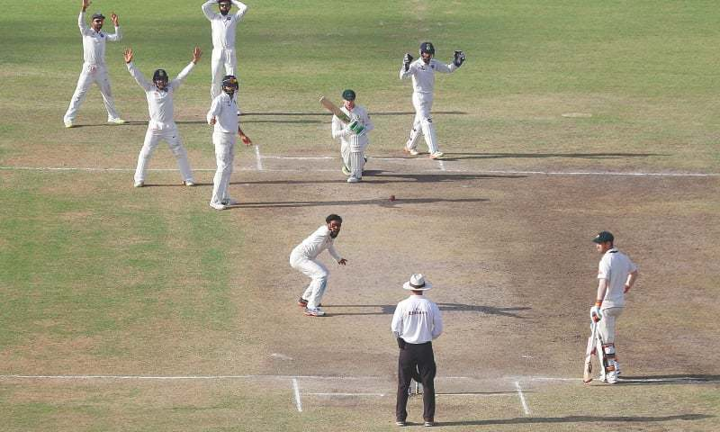 India's players appeal unsuccessfully for the dismissal of Australia's Peter Handscomb, top second right holding bat, during the fifth day of their third test cricket match in Ranchi, India, Monday. -AP