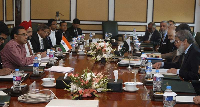 ISLAMABAD: The Indian delegation led by India's Indus Water Commissioner P.K. Saxena (left) holds talks with his Pakistani counterpart Mirza Asif Baig on Monday on water disputes between the two countries.—AP