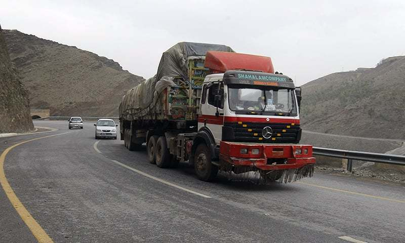 A truck carries goods on its way to Afghanistan through the Khyber Pass. —AP