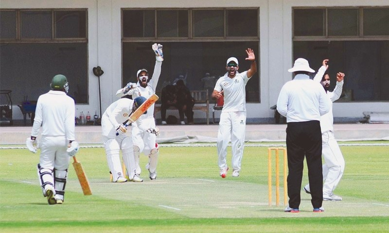 MULTAN: A view of the Quaid-i-Azam Trophy Grade-II match between Bahawalpur and Multan at the Multan Cricket Stadium on Thursday.—APP