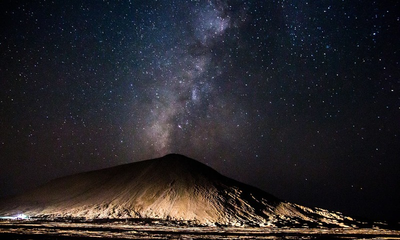 The Milky Way rises behind Chandragrup, the largest active mud volcano in the region - Photo by Abubaker Shekhani