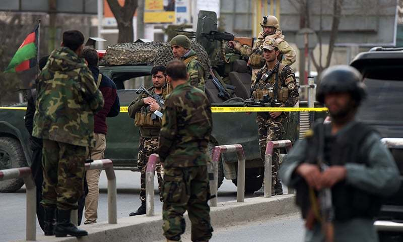 Afghan security personnel gather near the site of the explosion.—AFP/File