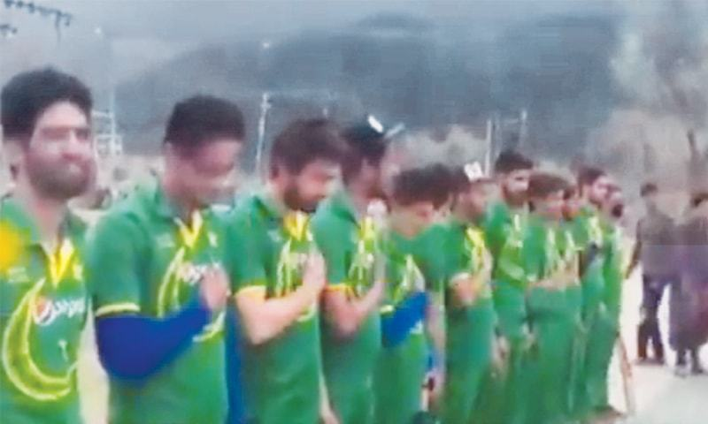 A grab from the video clip shows players listening to Pakistan's national anthem just before  the match.