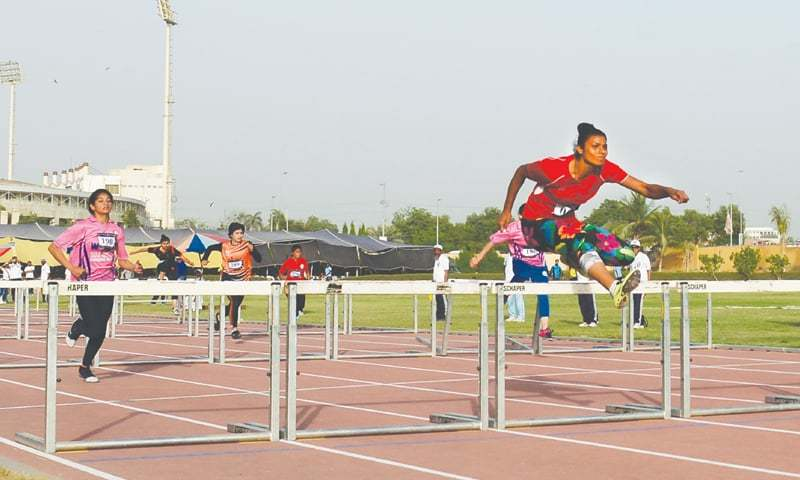 KARACHI: Maria Maratab of Army clears the last hurdle during the women's 100 metres hurdles final on Saturday.—Tahir Jamal / White Star