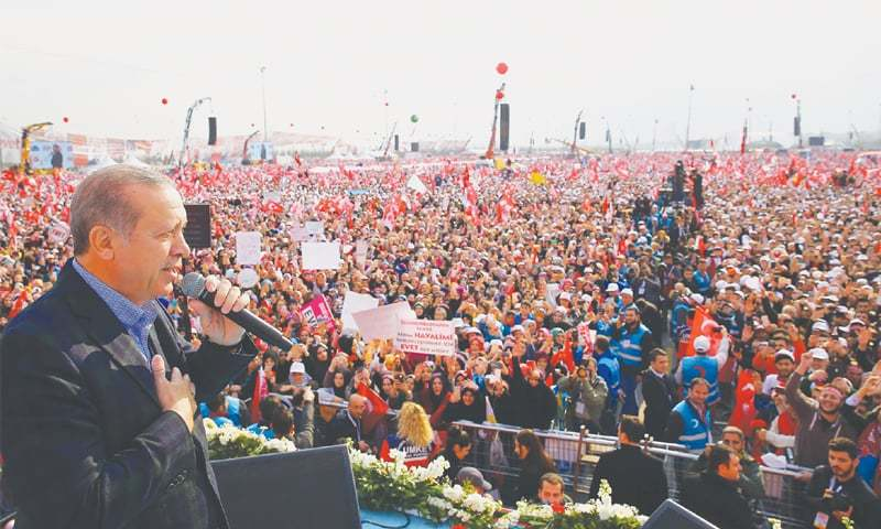Istanbul: Turkish President Recep Tayyip Erdogan delivering a speech during a campaign rally for the  'yes' vote in a constitutional referendum.—AFP