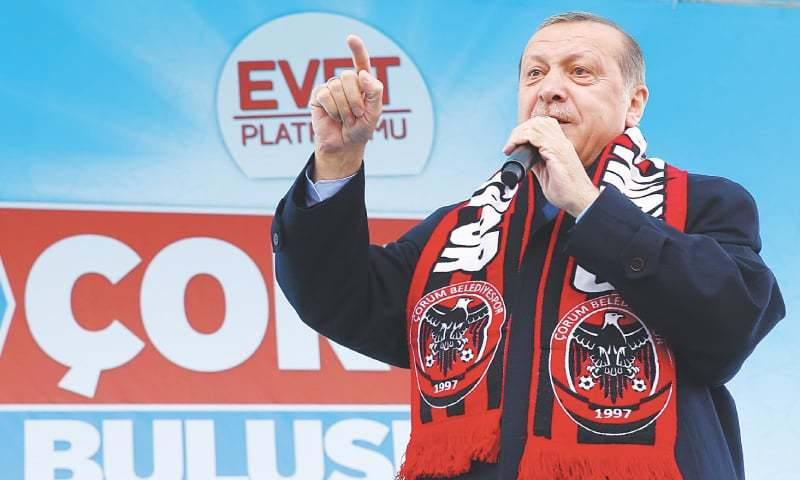 TURKISH President Recep Tayyip Erdogan addresses his supporters during a referendum rally in Corum, Turkey, on Monday.—AP