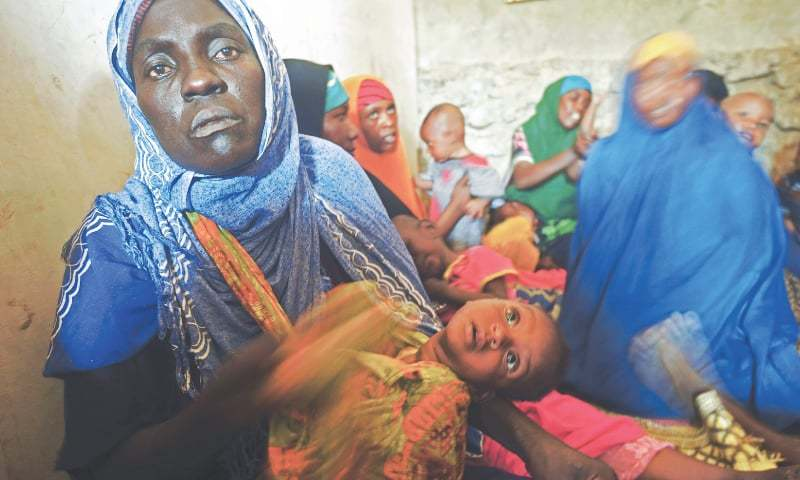 Dosplaced Somali women with their malnourished children — AFP