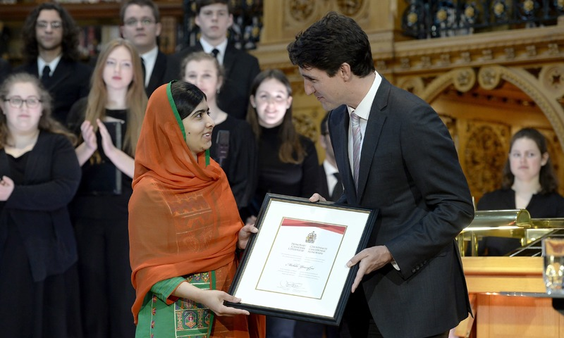 Malala Yousafzai is presented with an honorary Canadian citizenship by Prime Minister Justin Trudeau in on Parliament Hill in Ottawa. —AP