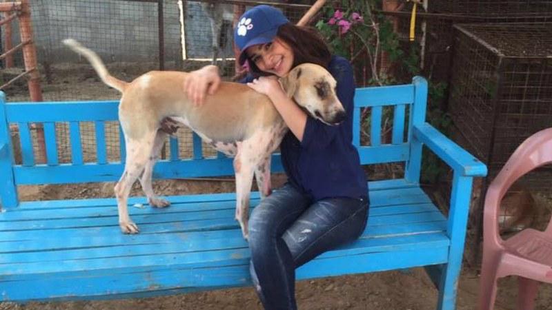 Ayesha Omar poses with one of the rescues at Ayesha Chundrigar Foundation's shelter