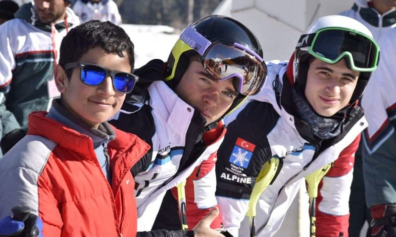 Fazal (L) with international skiiers from Turkey