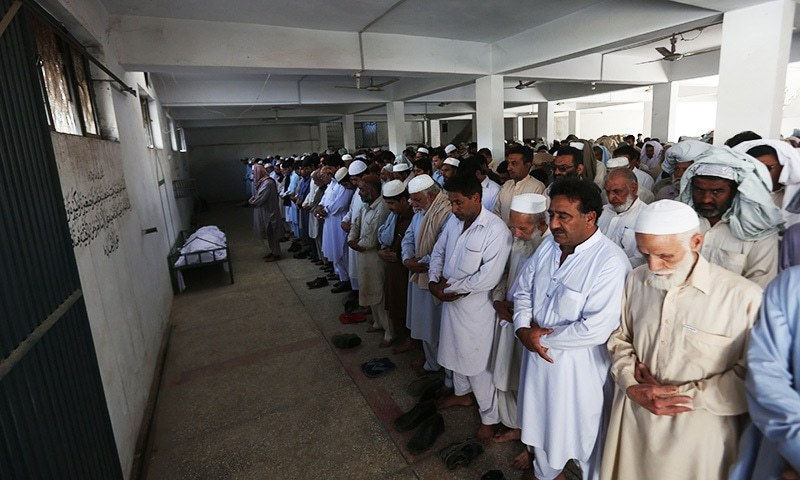 Relatives and residents offer funeral prayers for student Mashal Khan during his funeral in Swabi on April 14.— AFP