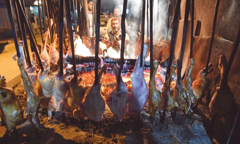 Hunks of goat spiked through with large skewers roast slowly in the heat of coals to make sajji | Photos by Banaras Khan