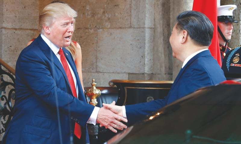 President Donald Trump shakes hands with Chinese President Xi Jinping as he arrives before dinner at Mar-a-Lago resort, in Palm Beach, Fla. In recent weeks, Trump has moved away from his tough campaign rhetoric on trade. Trump's threat to slap harsh tariffs on Chinese goods has given way to a bid to mend fences with Beijing.—AP