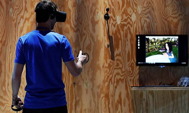 An attendee tries the new Facebook Spaces virtual reality platform during the annual Facebook F8 developers conference in San Jose, California. ─ Reuters