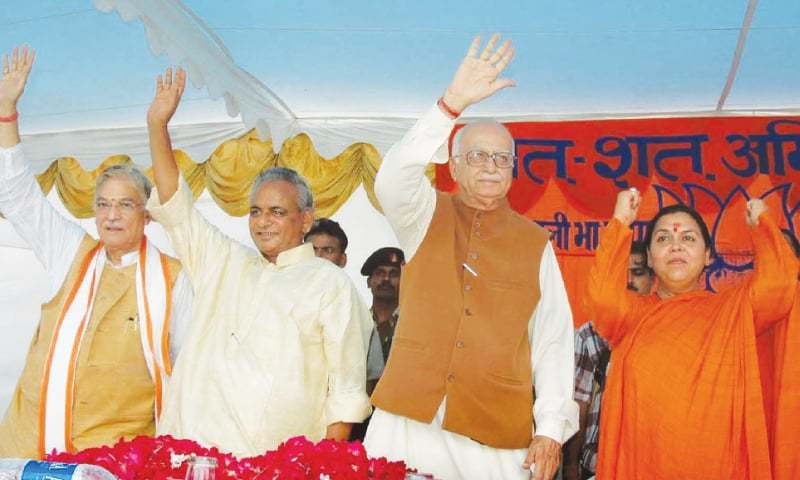In this July 28, 2005 file photo, Indian opposition leader and president of the Bharatiya Janta Party (BJP) LK Advani (second right), senior BJP leaders Uma Bharati (right), Kalyan Singh (second left) and Murli Manohar Joshi wave to people during a public rally in Rae Barreilly, Uttar Pradesh. ─ AP
