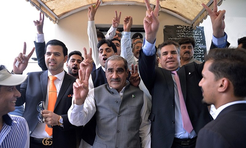 Leaders and supporters of ruling party PML-N celebrate after a Supreme Court verdict on the Panama Papers case outside the court building in Islamabad on April 20. — AFP