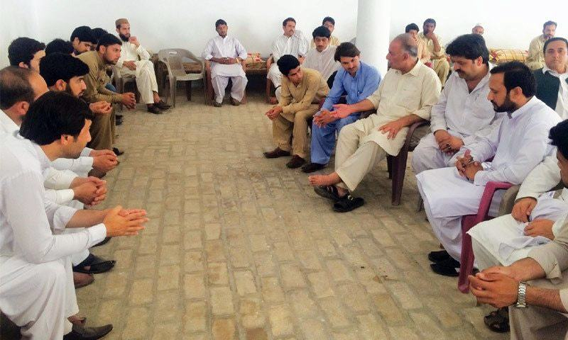 Mashal's father with guests offering condolences at Zaida village in Swabi.— Photo by writer
