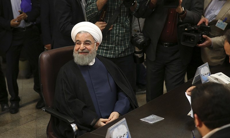 Iranian President Hassan Rouhani smiles as he attends at the Interior Ministry to register his candidacy for the May 19 presidential elections, in Tehran, on April 14. ─ AP