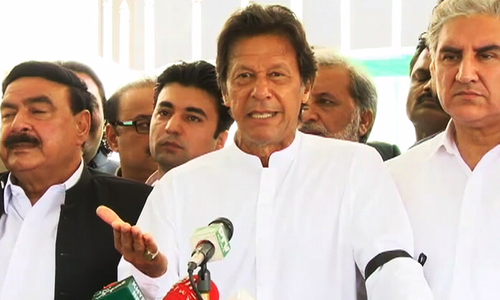 PTI Chairman Imran Khan addresses a press conference outside the National Assembly. ─ DawnNews
