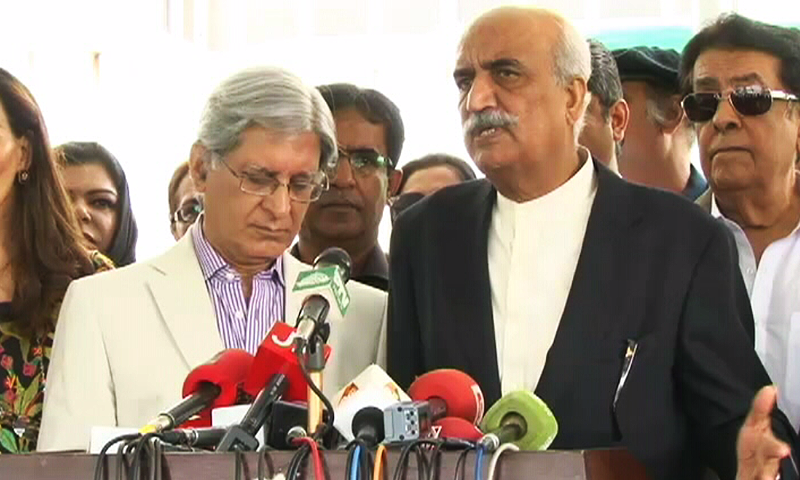 PPP's Aitzaz Ahsan and Khursheed Shah speak to reporters outside Parliament House. ─ DawnNews