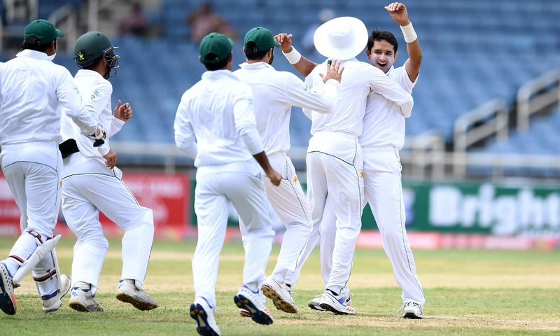 Mohammad Abbas celebrates with teammates after dismissing Kraigg Brathwaite. —AFP