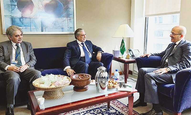 WASHINGTON: Finance Minister Ishaq Dar speaks to Saudi Finance Minister Mohammed Al Jadaan during a meeting on Sunday.—APP