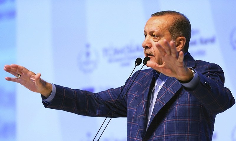 Turkey's President Recep Tayyip Erdogan gestures as he delivers a speech at a conference in Istanbul. ─ AP