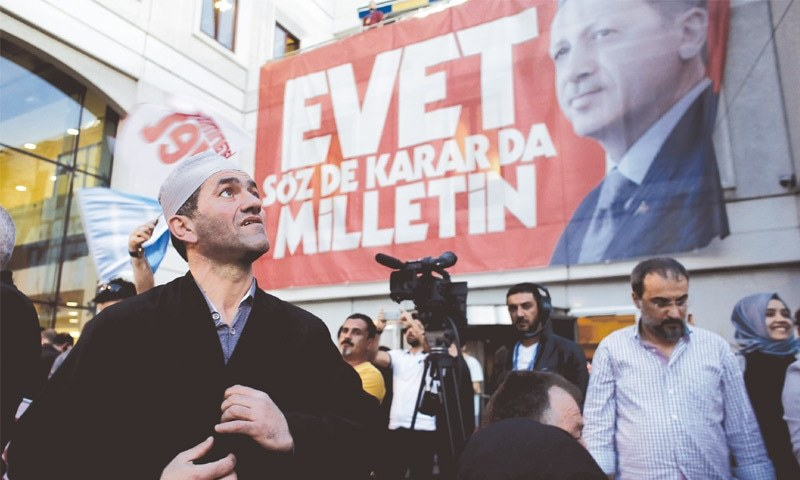 PEOPLE react outside the AKP party headquarters to the outcome of the referendum in Istanbul on  April 16.—Bloomberg