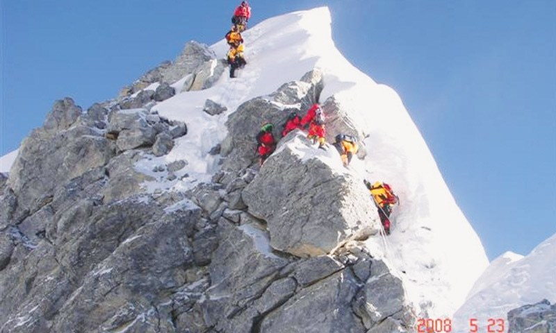 A CROWD of climbers at the infamous Hillary Step, the nearly vertical wall of rock and ice on Mount Everest.