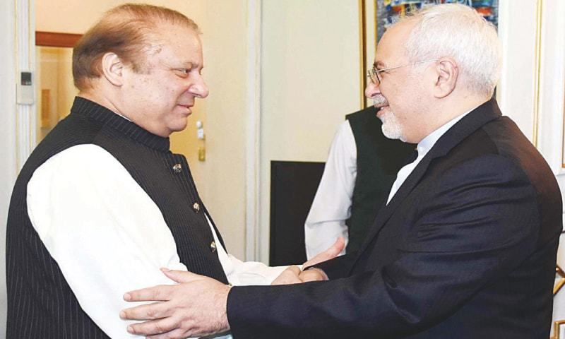 PM Nawaz shakes hands with Iranian Foreign Minister Javad Zarif at PM House.—PPI