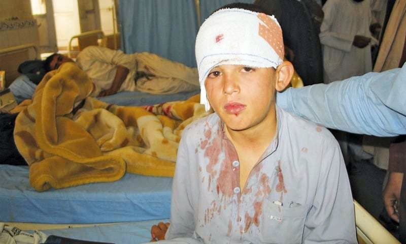 CHAMAN: A boy injured in firing from across the Afghan border receives treatment in a hospital.— Reuters