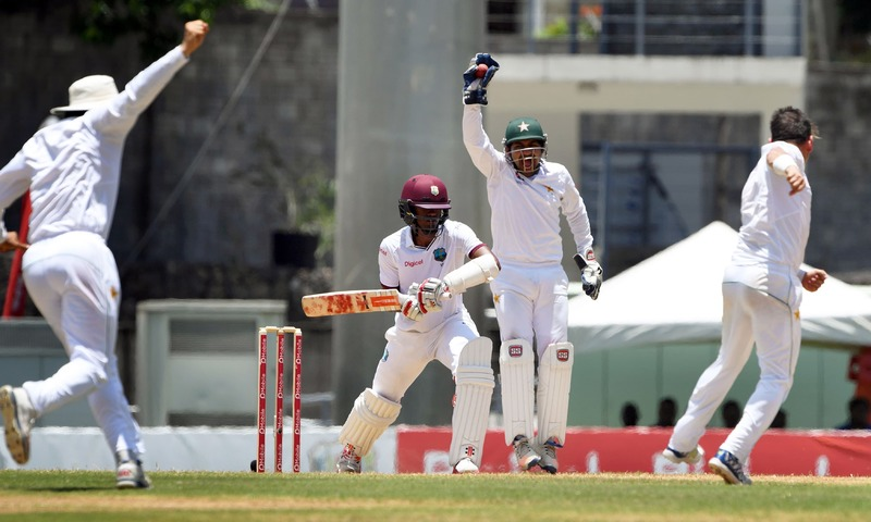 Sarfraz Ahmed successfully appeals for the wicket of Kraigg Brathwaite. —AFP
