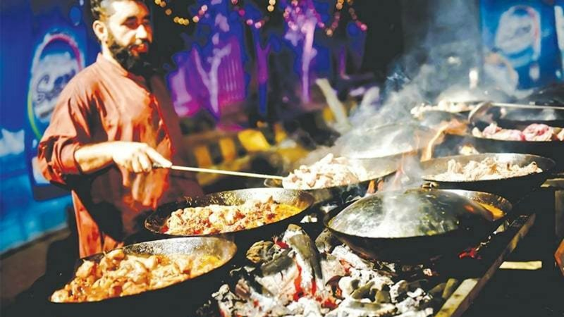 An expert chef prepares Peshawar's famous koyla karahi, enough to feed
