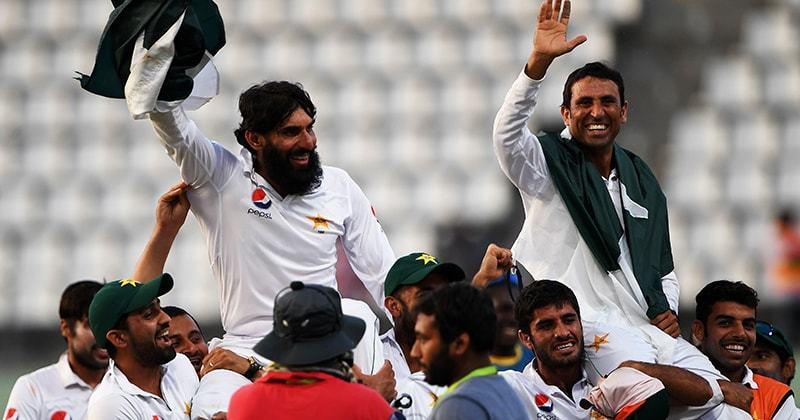 Retiring Pakistan cricket team members captain Misbah-ul-Haq and Younis Khan are carried by teammates as they celebrate after winning the final test match against the West Indies. -AFP