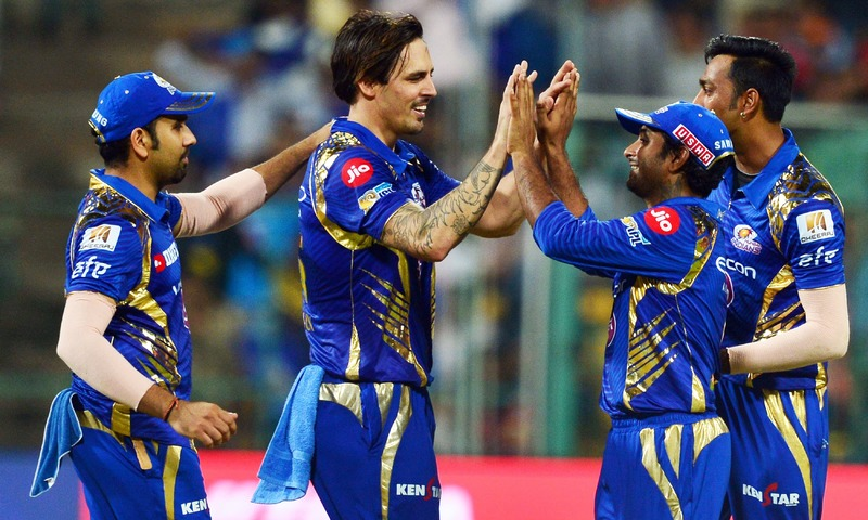 Mumbai Indians bowler Mitchell Johnson celebrates with teammates. —AFP