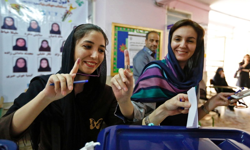 Women cast their ballots for the presidential elections at a polling station at the Lorzadeh mosque in Tehran. —AFP