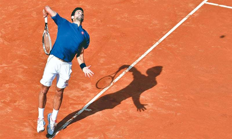 ROME: Serbia's Novak Djokovic serves to Roberto Bautista of Spain during their third-round match at the Italian Open.—AFP
